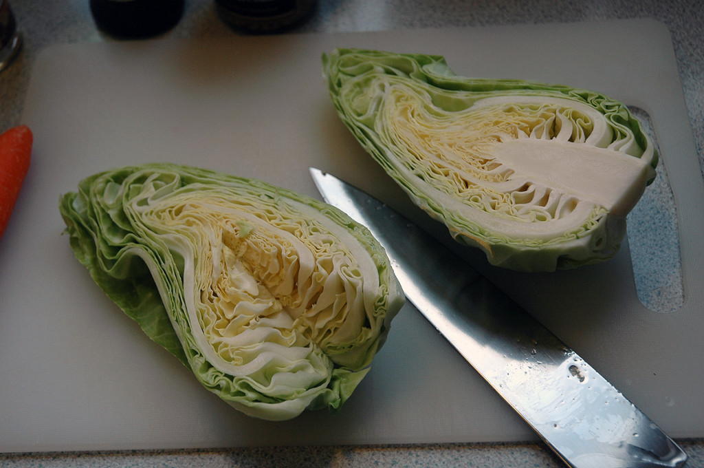 I prefer pointed cabbage over white cabbage in a coleslaw. It's less chewy and it looks and tastes better. Remove the stem and chop up.